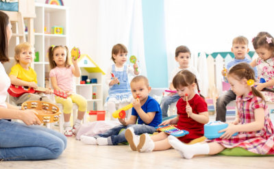 group of children play with musical toys