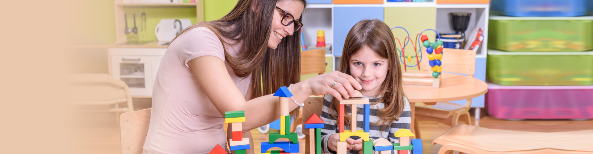 teacher and student playing with blocks